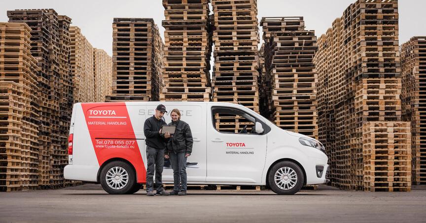 Technician with customer & van_Blog